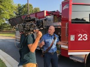 Dekalb-Fire-rescue-speaking-by-firetruck-CATMEDIA