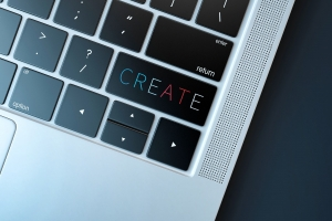 laptop with the word create