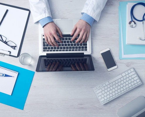 althcare in marketing doctor on a laptop